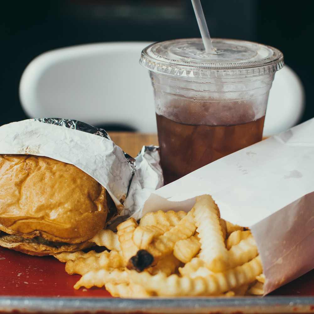 Fast food in paper and plastic packaging